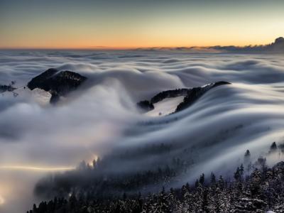 Fotografieren einer Nebelwelle mit Wetterfotografie.